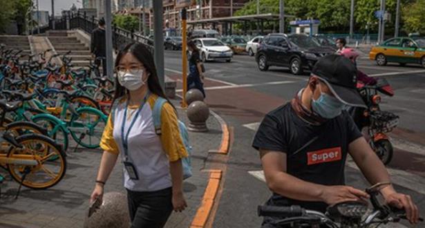 فرض حجر صحي على أحياء في بكين بعد ظهور بؤرة جديدة للفيروس في سوق