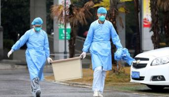"""منع سكان مدينة صينية من مغادرتها مع تسارع انتشار فيروس """"كورونا"""" الجديد"""