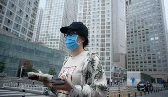 سلطات بكين ترفع معظم قيود التنقل وتعلن السيطرة على بؤرة الوباء