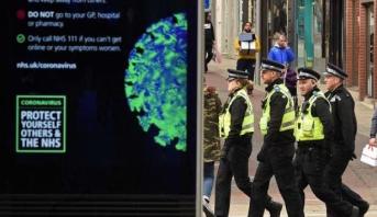 سجن شخص سعل في وجه شرطي في بريطانيا